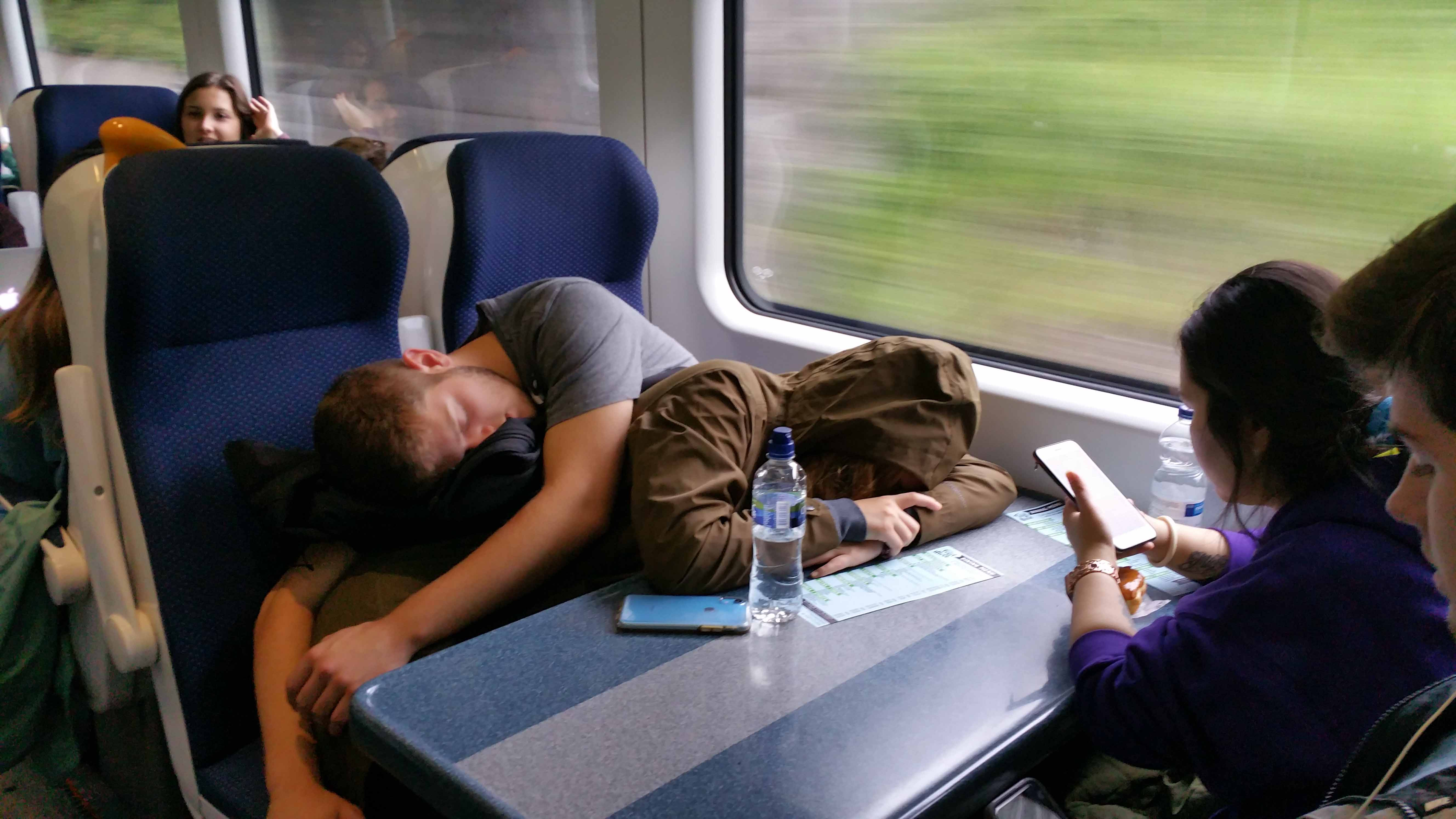 Students sleeping on the train