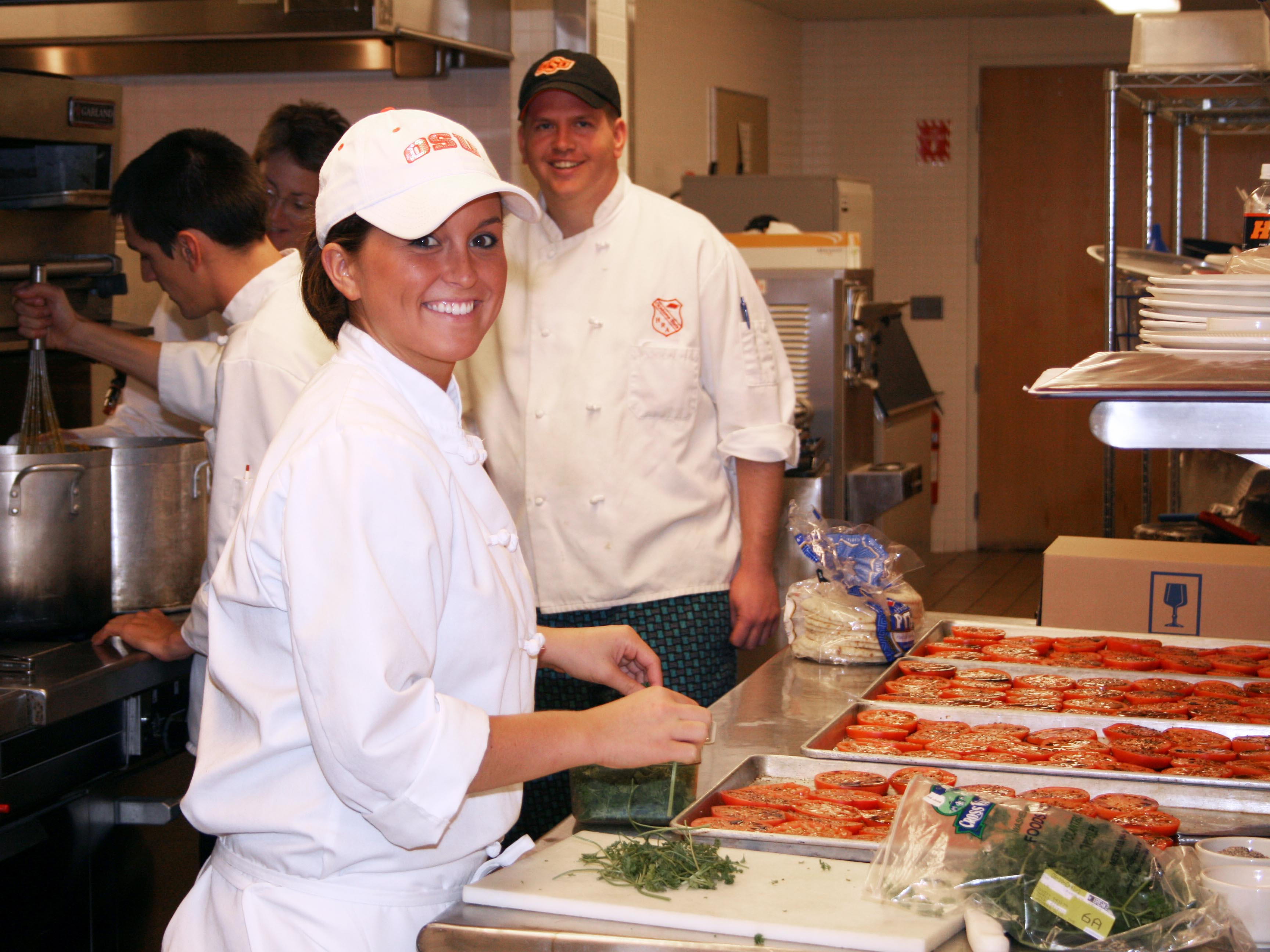 Student preparing a meal for a HTM event in 2007